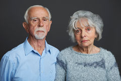 Studio Portrait Of Serious Senior Couple Stock Photos