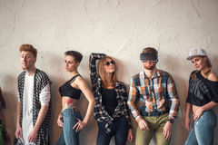 Studio portrait of seven young fashion attractive smiling caucasian women and men friends dressed jeans group together. Group of best friends having fun and stock photo