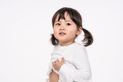 Studio portrait shot of 3-year-old Asian baby - isolated. Shot Royalty Free Stock Images