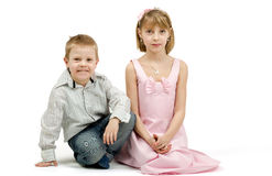 Studio portrait of siblings beautiful boy and girl Stock Images