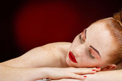 Studio portrait of sleeping woman Royalty Free Stock Images