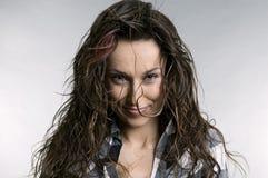 Studio portrait of smiley woman Stock Photo