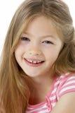 Studio Portrait of Smiling Girl Stock Photography