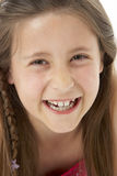Studio Portrait of Smiling Girl Royalty Free Stock Image