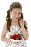 Studio Portrait of Smiling Girl Holding Bowl of St Royalty Free Stock Photography