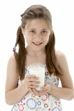 Studio Portrait of Smiling Girl Holding Glass of M Royalty Free Stock Image
