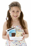 Studio Portrait of Smiling Girl Holding Lunchbox Royalty Free Stock Photo