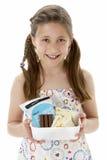 Studio Portrait of Smiling Girl Holding Lunchbox Royalty Free Stock Photo