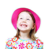 Studio portrait of a smiling little girl with hat. Studio portrait of a smiling little girl with pink hat isolated over white background stock photography
