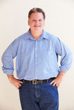 Studio Portrait Of Smiling Overweight Man Stock Photography