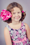 Pretty girl with a pink flower in her hair Stock Photography