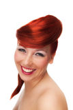 Studio Portrait of Smiling Redhead Woman Stock Image