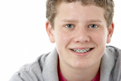 Studio Portrait of Smiling Teenage Boy Royalty Free Stock Images