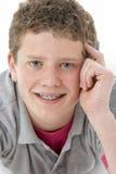 Studio Portrait of Smiling Teenage Boy Royalty Free Stock Image