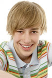 Studio Portrait Of Smiling Teenage Boy Stock Image