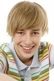 Studio Portrait Of Smiling Teenage Boy Stock Image