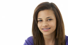 Studio Portrait of Smiling Teenage Girl Stock Photo