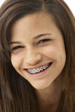 Studio Portrait of Smiling Teenage Girl Royalty Free Stock Images