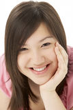 Studio Portrait of Smiling Teenage Girl Stock Photography