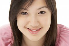 Studio Portrait of Smiling Teenage Girl Royalty Free Stock Image