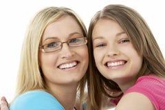 Studio Portrait of Smiling Teenage Girl with older Stock Image