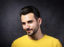 Studio portrait of a smiling youth looking at camera. Royalty Free Stock Photography