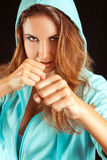 Studio portrait of sports woman on boxing stance Royalty Free Stock Photo
