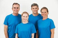 Studio Portrait Of Staff Wearing Uniform Against White Backgroun Royalty Free Stock Image
