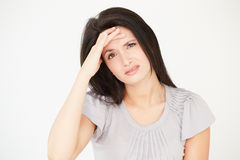Studio Portrait Of Stressed Woman Against White Background Stock Images