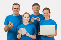 Studio Portrait Of IT Support Staff Wearing Uniform Against Whit Stock Photography