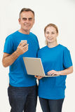 Studio Portrait Of IT Support Staff Wearing Uniform Against Whit Stock Image
