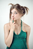 Studio portrait of surprised girl in green outfit Royalty Free Stock Photo