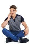 Studio Portrait Of Teenage Boy Talking On Mobile Phone Stock Photos