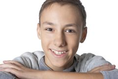 Studio portrait of teenage boy on white background stock photo
