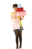 Studio Portrait Of Teenage Girl Carrying Packages Royalty Free Stock Photos