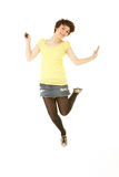 Studio Portrait Of Teenage Girl Jumping In Air Stock Images