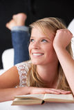 Studio Portrait Of Teenage Girl Reading Book Stock Photography