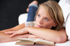 Studio Portrait Of Teenage Girl Reading Book Stock Image