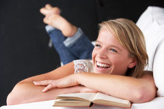 Studio Portrait Of Teenage Girl Reading Book Royalty Free Stock Image