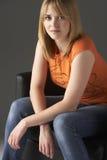 Studio Portrait Of Teenage Girl Sitting In Chair Stock Image
