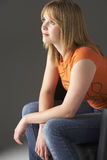 Studio Portrait Of Teenage Girl Sitting In Chair Stock Photography