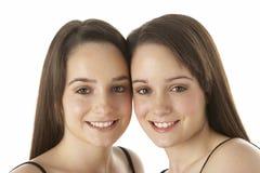 Studio Portrait Of Teenage Twins royalty free stock photography