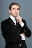 Studio portrait of thinking young business man. Royalty Free Stock Photo