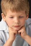 Studio Portrait Of Thoughtful Young Boy Stock Photo