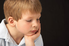 Studio Portrait Of Thoughtful Young Boy Stock Photography