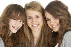 Studio Portrait Of Three Sisters Stock Photo