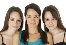 Studio Portrait Of Three Young Women Stock Image
