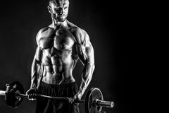 Hardy man doing exercise with heavy bar royalty free stock images
