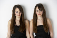 Studio Portrait Twin Teenage Girls royalty free stock image