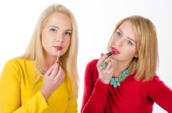 Studio portrait of two women with lipsticks Royalty Free Stock Photos